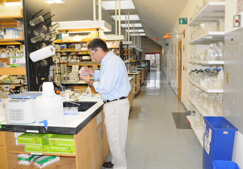 Zvi Kelman, director of NIST's new Biomolecular Labeling Laboratory, works near the lab's five user stations.
