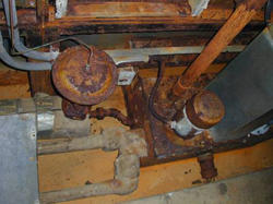 Corroding, leaking, 40-year-old mechanical equipment in a NIST mechanical room support space.
