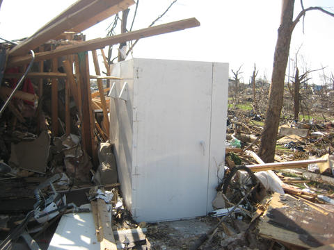 A steel shelter bolted to a concrete garage floor was all that remained of a wood-frame home destroyed in the Joplin, Mo., tornado of May 22, 2011.