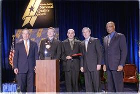 Pictured (Left to right): Commerce Secretary Don Evans; Nathaniel Moore, student, Chugach School District; Richard DeLorenzo, superintendent, Chugach School District; President Bush; Education Secretary Rod Paige.