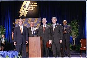 Pictured (Left to right): Commerce Secretary Don Evans; Pal Barger, chairman and founder, Pal's Sudden Service; Thomas Crosby, president and CEO, Pal's Sudden Service; President Bush.