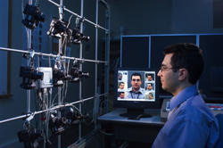 NIST computer scientist Ross Micheals demonstrates a NIST-developed system for studying the performance of facial recognition software programs.