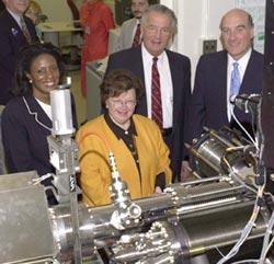 Officials are briefed about new nanotechnology research at the National Institute of Standards and Technology after the ceremonial groundbreaking for the Advanced Measurement Laboratory.