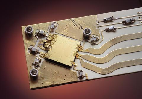 Gold ion trap on aluminum nitride backing