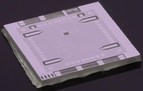 Photo of the NIST optics table on a chip