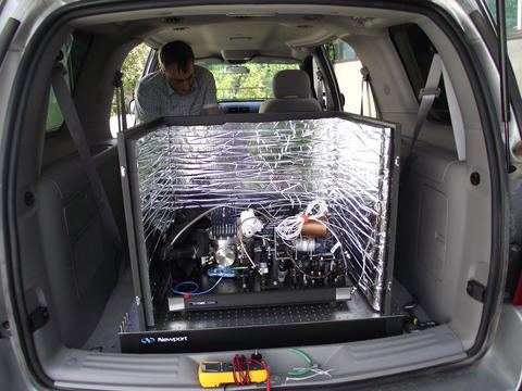 Photo of an advanced laser in the back of a car