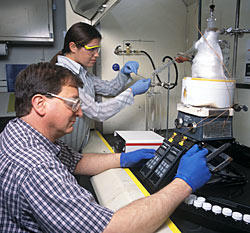 NIST chemists Thomas Bruno and Beverly Smith analyze complex fuel mixtures with the new advanced distillation curve apparatus.
