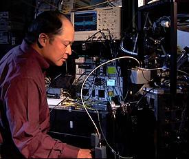 NIST engineer Sae Woo Nam working on a photo detector