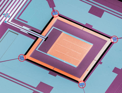 Colorized micrograph of a NIST chip combining four micro-refrigerators with a superconducting sensor