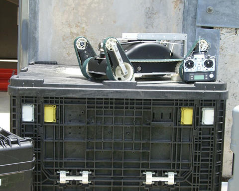 Urban search and rescue robot and its control unit sit atop one of the packing crates