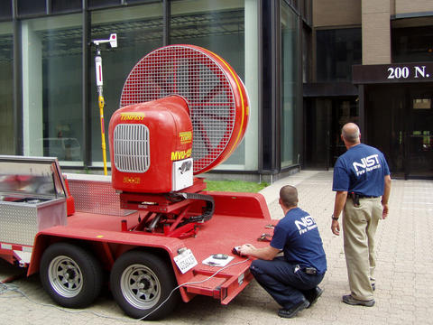Photo of a mounted fan outside of a building