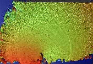 Optical profilometer image of the broken surface of a glass rod shows height of peaks and valleys of the fracture surface in millionths of a meter.