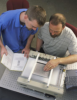 Researchers John Roberts and Oliver Slattery using the tactile graphic display device