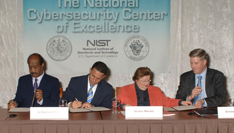 Photo of MOU signing for NCCoE