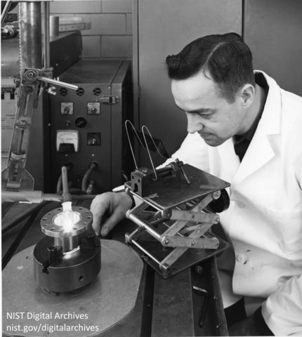 Ralph Orwick bending over a tungsten electrode welder