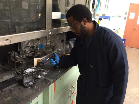GMSE graduate student Andre Thompson in one of NIST's Fire Research laboratories, testing the flammability of materials