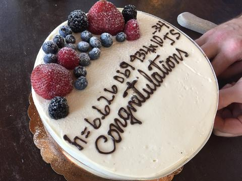 cake with winning guess of Planck's constant value written on it