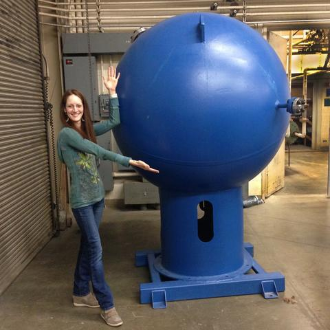 NIST researcher Jodie Pope with the big blue ball