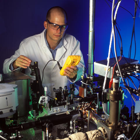 Researcher with the quantum logic clock