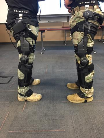 The legs of two soldiers with exoskeletons