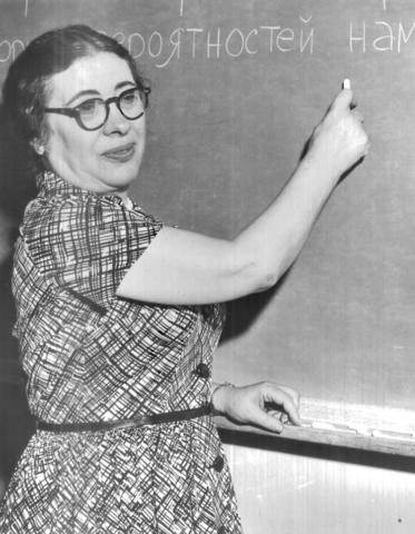 Ida Rhodes stands at a chalkboard