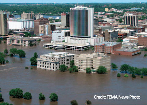 Buildings, including high rises, with water flooding the area.