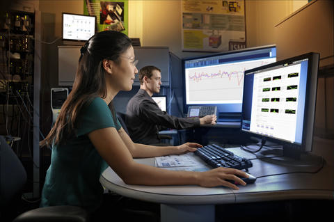 two people sit at computers