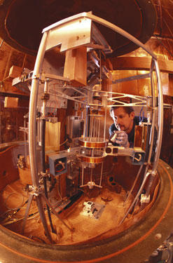 Physicist Richard Steiner adjusts the electronic kilogram, an experimental apparatus for defining mass in terms of the basic properties of nature.