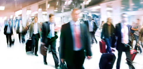 Blurry image of people in airport