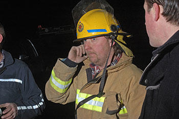 firefighter on a phone