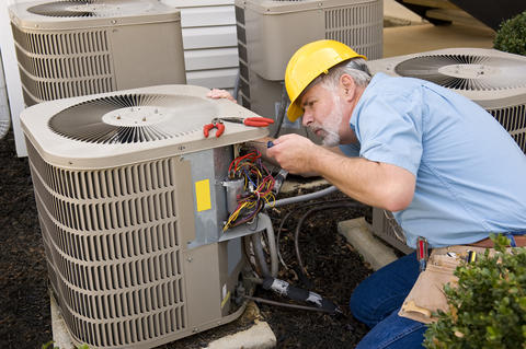 man working on heat pump unit
