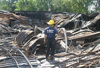 NIST researcher photographing the remains of the Sofa Super Store in Charleston, S.C., on June 19, 2007, the day after the fire that killed nine firefighters.