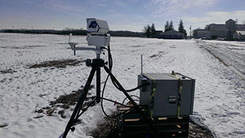 A  laser scanner monitors a field near Ft. Wayne, Indiana, for carbon dioxide leaking from underground.