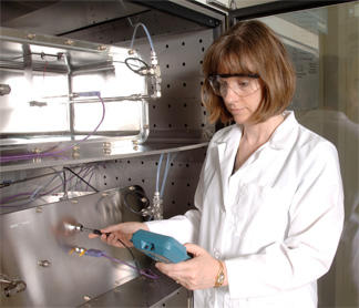 Using NIST's small chamber test facility, researchers are assessing the performance of a prototype reference material to improve the measurement of volatile organic compound emissions from building products.