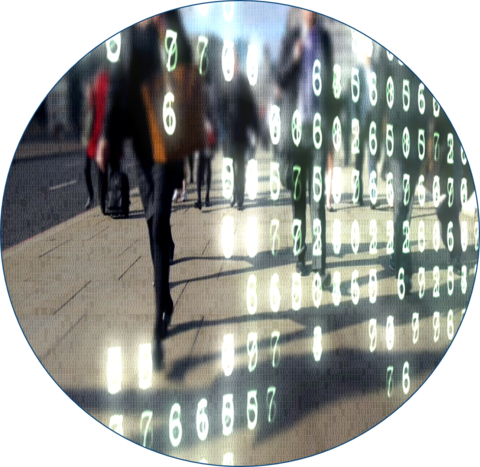 circle with image inside of a crosswalk with people walking around a city and coding in the forefront of the image