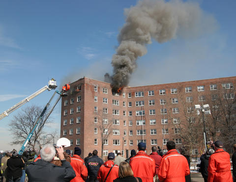 NIST Fire Research Division engineers use an abandoned New York City brick high-rise as a seven-story fire laboratory to better understand the fastmoving spread of wind-driven flames, smoke and toxic gases through corridors and stairways of burning buildings.