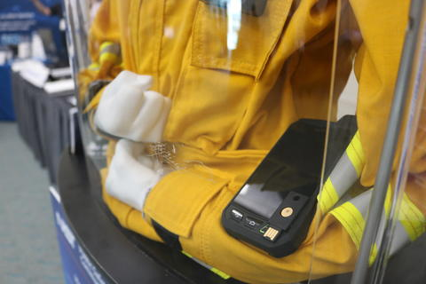 Photo of a mannequin wearing a yellow jacket and wearable technology
