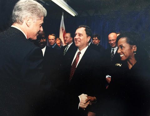 Photo of Jacqueline Calhoun meeting President Clinton at the Baldrige Award Ceremony.