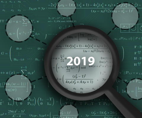 "A magnifying glass with ""2019"" in its lens hovers over a green field of math equations, with circles suggesting the magnifying glass has located some of the information."