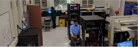 Researchers making measurements in the NIST Smart Grid Testbed