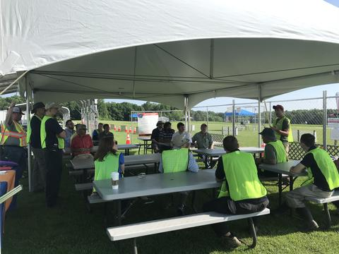 Subject matter expert volunteers brief a competing team at the UAS drone challenge in 2018