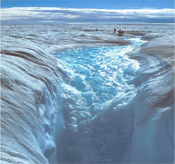 A glacial-melt stream on the top of the Greenland ice sheet in late summer. The stream is falling into a moulin where it travels to the base of the ice sheet.