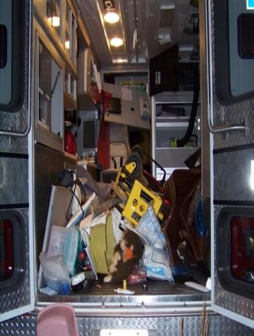 inside of an ambulance with interior a mess after a crash.