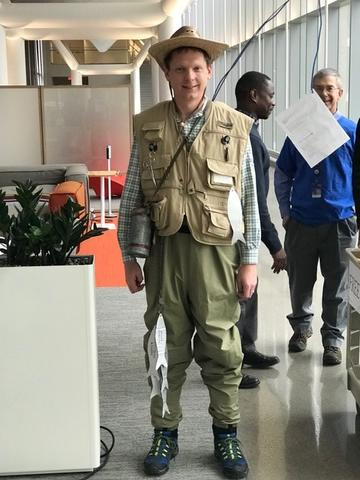 KUMC IS Director Jeffrey Pennington is shown standing while wearing a fisherman costume.