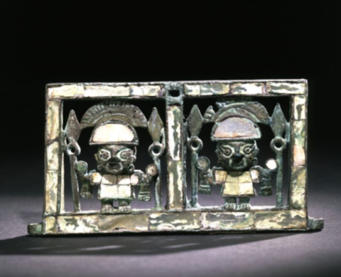 a small metal balance featuring two figurines