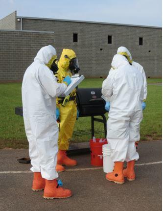 First responders collecting samples of the yeast surrogate material during a field exercise.  (Credit: NIST)