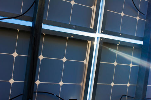 Sunlight shines through solar panel backsheet.