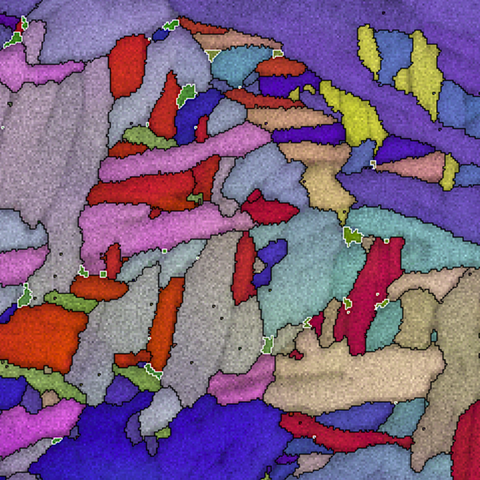 Microscope image shows multicolored jagged shapes