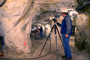Electronics engineer Dennis Camell aligns antennas in an old California silica mine for a NIST study identifying optimal frequencies for radio signal transmissions in tunnels.