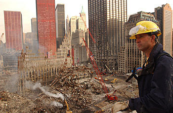 Worker looks over the disaster site at New York City's World Trade Center